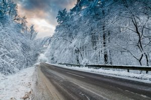Photo of an icy road, consider security this winter